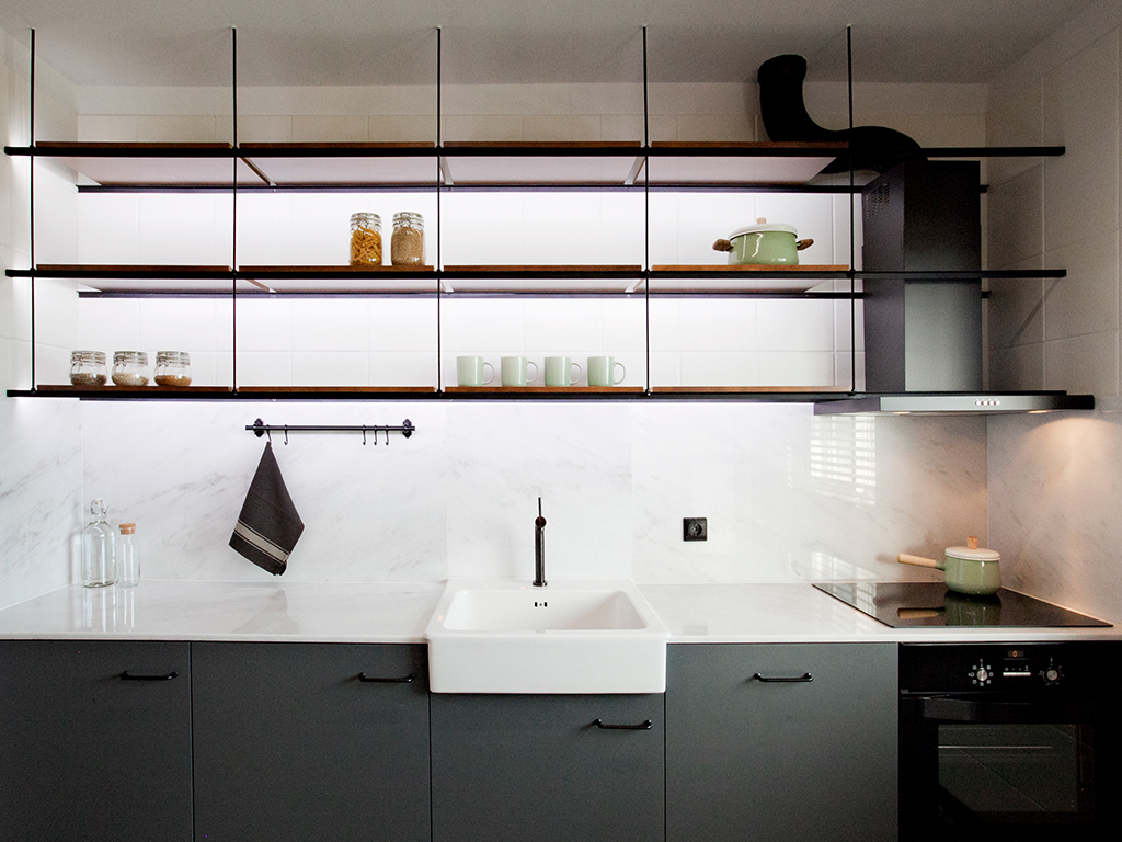 Black kitchen with ceramic sink